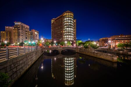 providence: Modern buildings and the Providence River at night, in downtown Providence, Rhode Island.