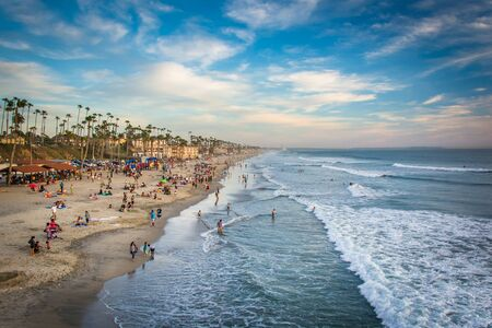 oceanside: View of the beach from the pier at sunset, in Oceanside, California.