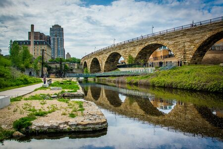 The Stone Arch Bridge, in downtown Minneapolis, Minnesota. Stock Photo