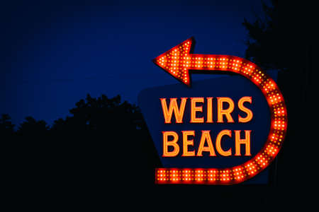laconia: The Weirs Beach sign at night, in Laconia, New Hampshire. Stock Photo