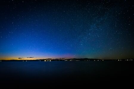 laconia: The Milky Way over Lake Winnipesaukee at night, at Ellacoya State Park, in Laconia, New Hampshire.