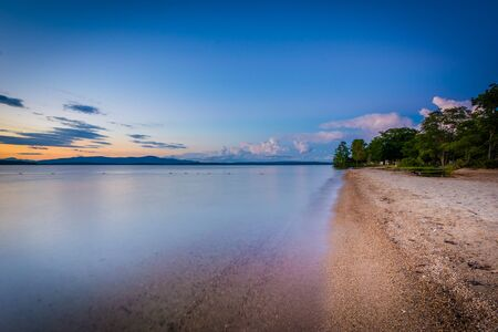 laconia: The shore of Lake Winnipesaukee at sunset, at Ellacoya State Park, in Laconia, New Hampshire.