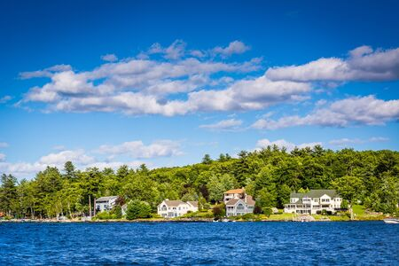 laconia: Houses along Lake Winnipesaukee in Weirs Beach, Laconia, New Hampshire. Stock Photo