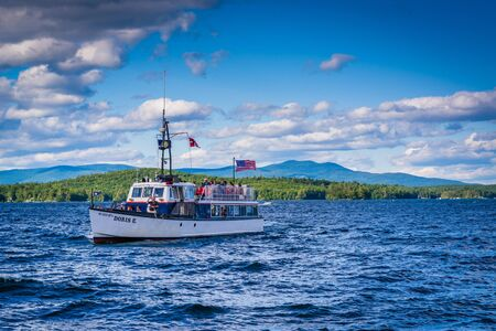 laconia: Boat in Lake Winnipesaukee in Weirs Beach, Laconia, New Hampshire. Editorial