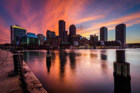 dark city: The downtown skyline at sunset, seen from Fort Point in Boston, Massachusetts.