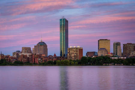 View of the Charles River and  buildings in Back Bay at sunset from Cambridge, Massachusetts. Stock Photo
