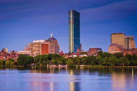 back bay: View of the Charles River and  buildings in Back Bay at twilight from Cambridge, Massachusetts. Stock Photo