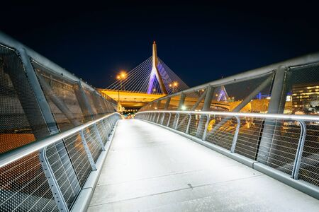 The North Bank Pedestrian Bridge and Leonard P. Zakim Bunker Hill Memorial Bridge at night, in Cambridge, Massachusetts. Stock Photo