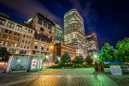 federal reserve: Highrises and the Federal Reserve Plaza Park at night, in the Financial District, Boston, Massachusetts. Stock Photo