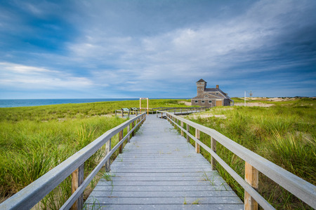 Boardwalk and the Old Harbor U.S. Life Saving Station, at Race Point, in the Province Lands at Cape Cod National Seashore, Massachusetts.