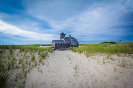 life saving: Sand dunes and grasses, and the Old Harbor U.S. Life Saving Station, at Race Point, in the Province Lands at Cape Cod National Seashore, Massachusetts. Stock Photo