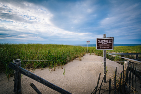 Fence and sand dunes at Race Point,  in the Province Lands at Cape Cod National Seashore, Massachusetts. Stock Photo