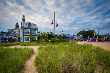 Grasses and buildings along the beach in Provincetown, Cape Cod, Massachusetts. Stock Photo