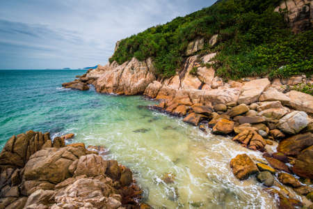 Rocky coast at Shek O Beach, on Hong Kong Island, Hong Kong.