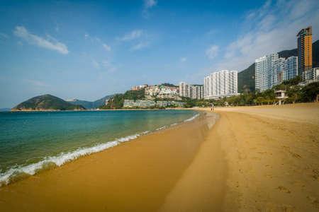 repulse: Beach and skyscrapers at Repulse Bay, in Hong Kong, Hong Kong. Stock Photo
