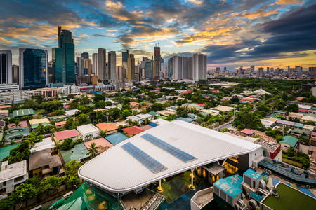 View of the skyline of Makati at sunset, in Metro Manila, The Philippines. Stock Photo