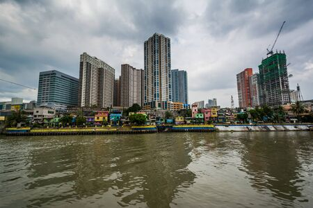 Buildings in Mandaluyong and the Pasig River seen from Makati, Metro Manila, The Philippines. Stock Photo