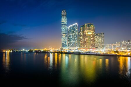Skyscrapers in Kowloon at night, seen from Tsim Sha Tsui, in Kowloon, Hong Kong. Stock Photo