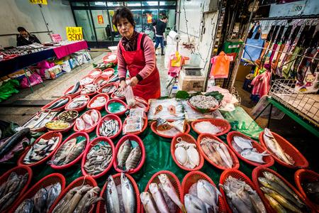 fish vendor: Fish vendor at a street market in the Zhongzheng District, Taipei, Taiwan.