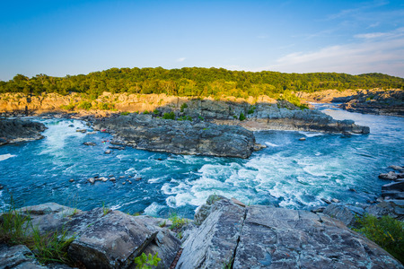rapids: View of rapids in the Potomac River at sunset, at Great Falls Park, Virginia.