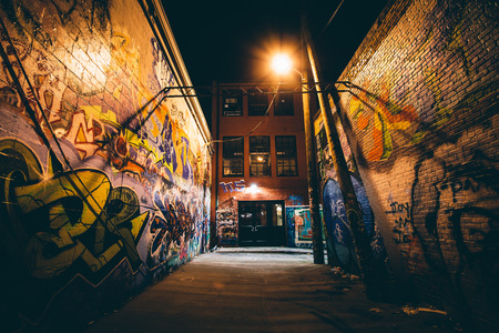 Graffiti Alley at night, in the Station North District, of Baltimore, Maryland. Editorial