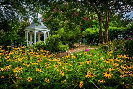 Colorful garden and gazebo in a park in Alexandria, Virginia.