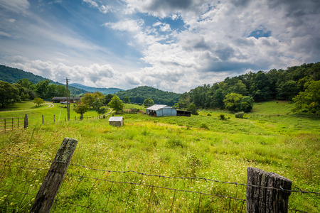 Fence and view of a farm in rural Shenandoah Valley of Virginia.