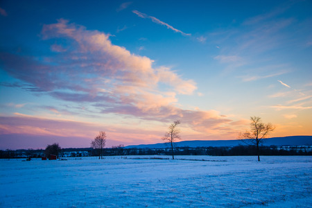 frederick: Winter sunset over a farm field in rural Frederick County, Maryland. Stock Photo