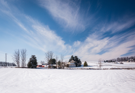 wispy: Wispy clouds over a snow covered farm in rural Carroll County, Maryland.
