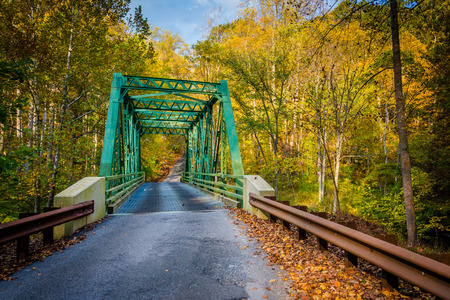 Autumn color and old bridge over Gunpowder Falls in rural Baltimore County, Maryland.