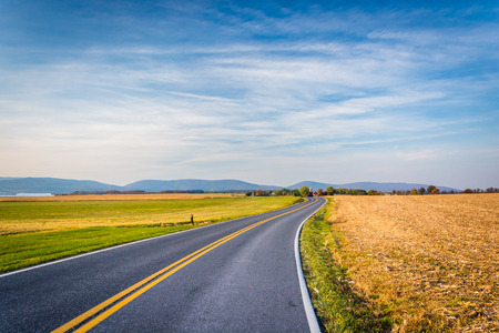 frederick street: Country road and distant mountains in rural Frederick County, Maryland. Stock Photo