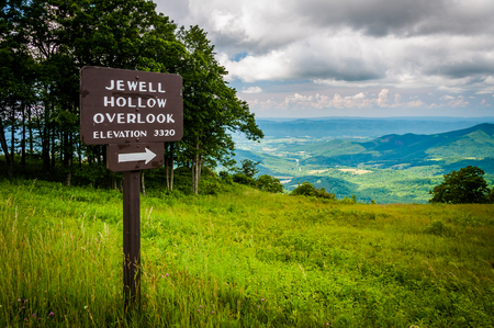 Sign for Jewell Hollow Overlook and view of the Shenandoah Valley, along Skyline Drive, in Shenandoah National Park, Virginia. Stock Photo