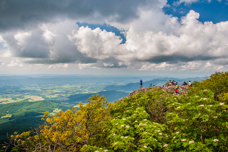 rural skyline: People on the summit of Stony Man Mountain and view of the Shenandoah Valley, in Shenandoah National Park, Virginia. Stock Photo