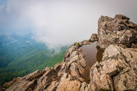 blue ridge: Water puddle on Little Stony Man Cliffs and foggy view of the Blue Ridge, in Shenandoah National Park, Virginia.