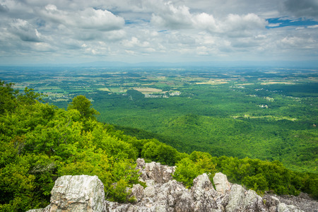View of the Shenandoah Valley and Blue Ridge Mountains from the rocky summit of Turk Mountain in Shenandoah National Park, Virginia.