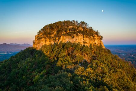 The Big Pinnacle of Pilot Mountain, seen at sunset from Little Pinnacle Overlook at Pilot Mountain State Park, North Carolina.