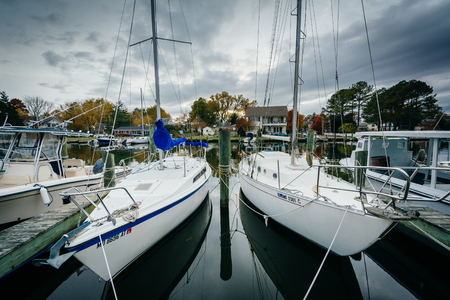docked: Boats docked in the Miles River, in St. Michaels, Maryland. Stock Photo