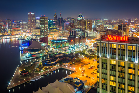 Aerial view of the Inner Harbor at night, in Baltimore, Maryland. Editorial
