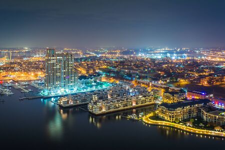 maryland: Aerial view of Federal Hill and the Inner Harbor at night, in Baltimore, Maryland.
