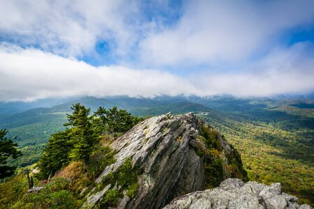 wnc: Rocky outcrop and view of the Blue Ridge Mountains, at Grandfather Mountain, North Carolina.