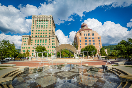 Fountains at Park Square Park and buildings in downtown Asheville, North Carolina.