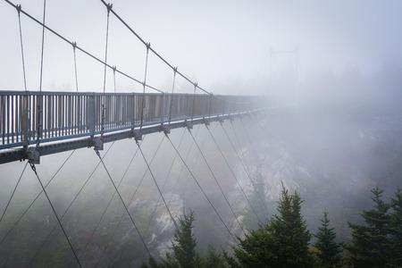 wnc: The Mile High Swinging Bridge in fog, at Grandfather Mountain, North Carolina.