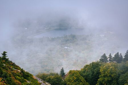 wnc: View of Grandfather Lake in fog, from Grandfather Mountain, North Carolina.