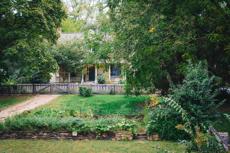Gardens and house in the Old Salem Historic District, in Winston-Salem, North Carolina. Stock Photo