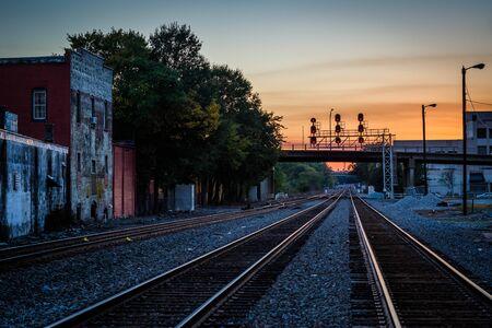 Railroad tracks at sunset, in downtown Greensboro, North Carolina.