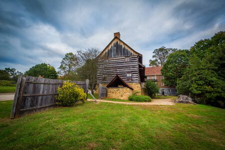 Fence and old barn in the Old Salem Historic District, in Winston-Salem, North Carolina. Stock Photo