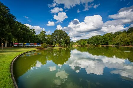charlotte: Beautiful clouds reflecting in the lake at Freedom Park, in Charlotte, North Carolina.