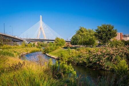 leonard: The Leonard P. Zakim Bunker Hill Memorial Bridge and a canal at North Point Park, in Cambridge, Massachusetts.