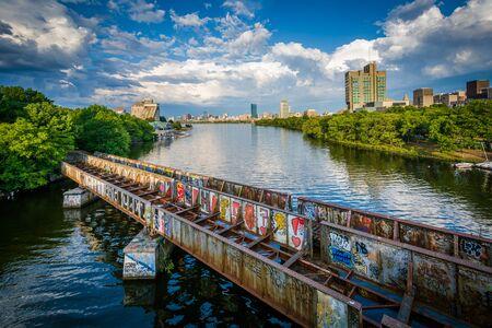 Graffiti-covered railroad bridge and the Charles River, seen from the Boston University Bridge, in Boston, Massachusetts.