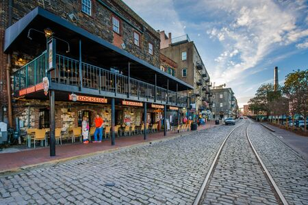 The cobblestone River Street, and old buildings in Savannah, Georgia.